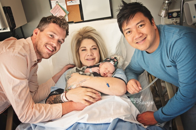 Tim Bangsund, Lisa Beaulieu and Chewn Bangsund gather for a photo with Florence Juniper Pham Bangsun. Florence was born on Nov. 6. Lisa served as the surrogate for the Bangsunds. Photo by Angyl Ravyn Photography