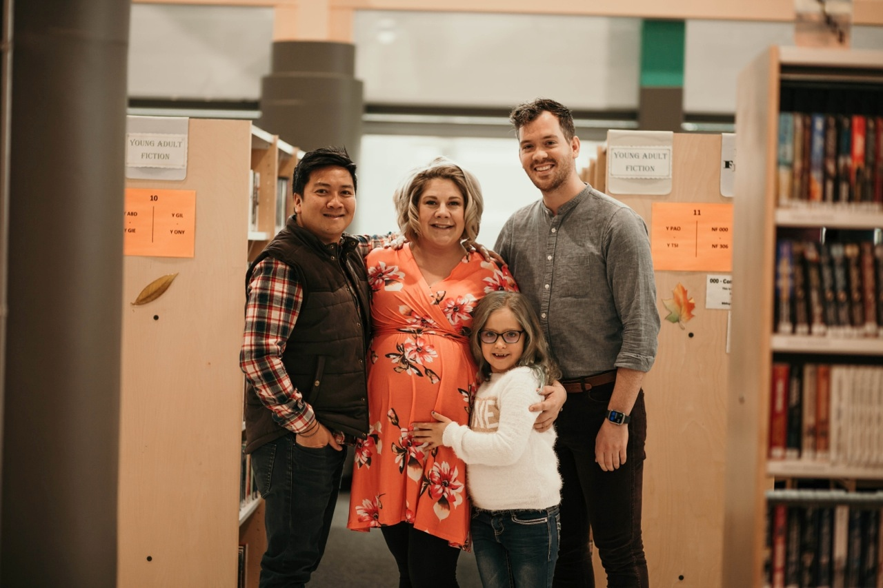 Chewn Bangsund, left, and Tim Bangsund with Lisa Beaulieu and her daughter Lyric before Florence was born. Photo by Lacie Paige Photography